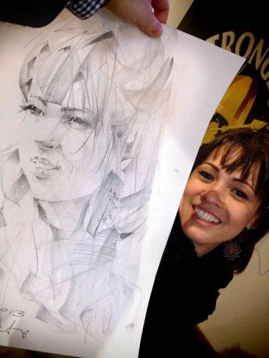 Ana e seu retrato em grafite, feito por um artista polonês